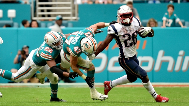 New England Patriots running back Sony Michel (26) and Miami Dolphins outside linebacker Kiko Alonso (47)