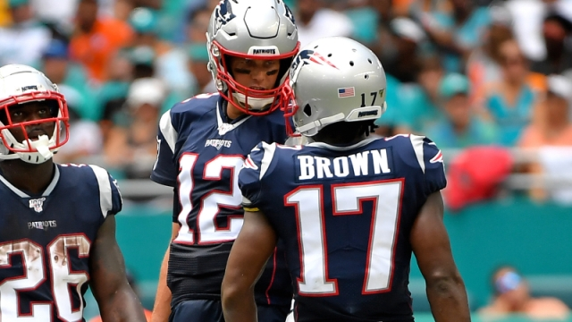 New England Patriots quarterback Tom Brady (center), former wide receiver Antonio Brown (right) and running back Sony Michel (left)