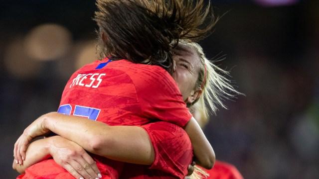 United States midfielder Lindsey Horan (9) and forward Christen Press (23)