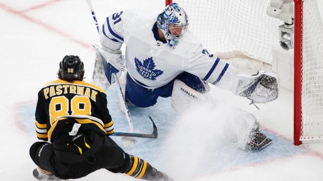 Toronto Maple Leafs goaltender Frederik Andersen (31) and Boston Bruins right wing David Pastrnak (88)
