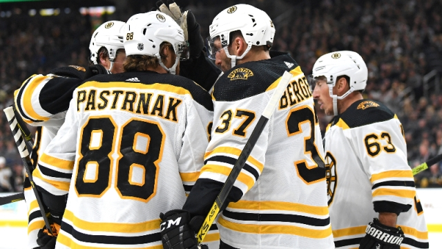 ; Boston Bruins right wing David Pastrnak (88) and teammates