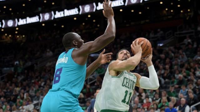 Boston Celtics center Enes Kanter (11) and Charlotte Hornets center Bismack Biyombo (8)