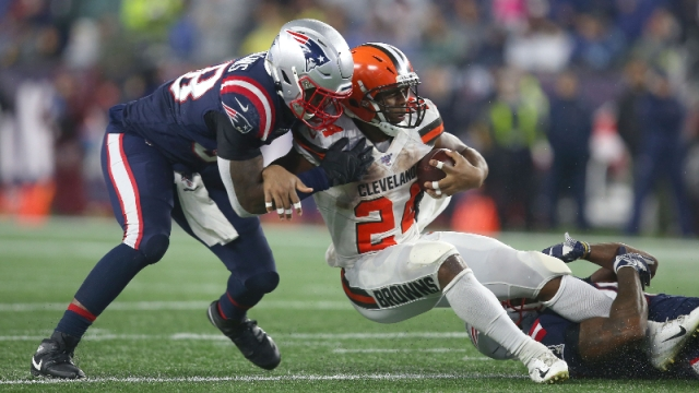 Cleveland Browns running back Nick Chubb (24) and New England Patriots linebacker Jamie Collins Sr. (58)