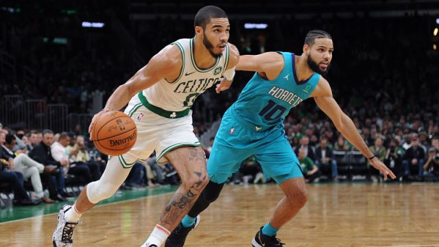 Boston Celtics forward Jayson Tatum and Charlotte Hornets forward Caleb Martin
