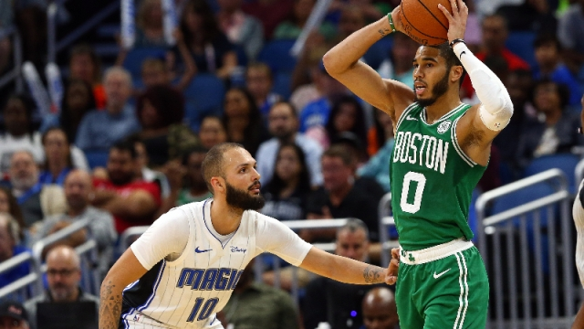 Boston Celtics forward Jayson Tatum (0) and Orlando Magic guard Evan Fournier (10)