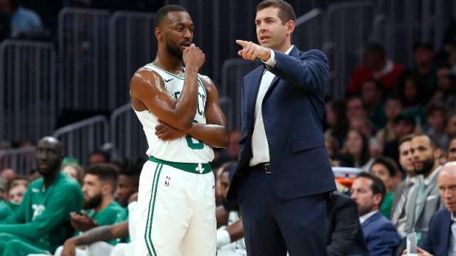 Boston Celtics head coach Brad Stevens and guard Kemba Walker (8)