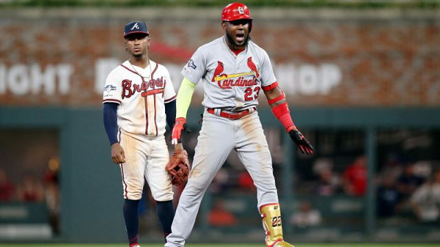 Atlanta Braves second baseman Ozzie Albies and St. Louis Cardinals left fielder Marcell Ozuna