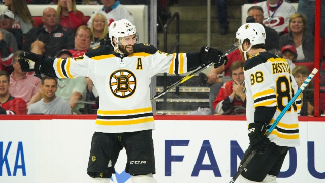 Boston Bruins center Patrice Bergeron (37) and right wing David Pastrnak (88)