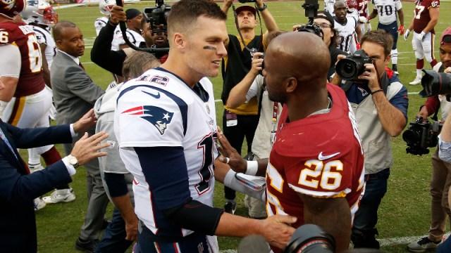New England Patriots quarterback Tom Brady (12) and Washington Redskins running back Adrian Peterson (26)
