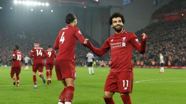 Liverpool defender Virgil van Dijk (4) and Mohamed Salah (11)