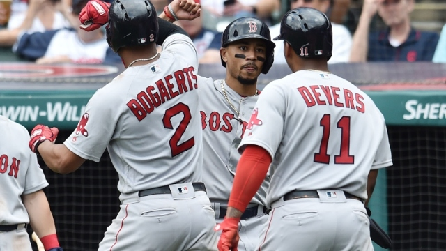 Boston Red Sox shortstop Xander Bogaerts (2), right fielder Mookie Betts (middle) and third baseman Rafael Devers (11)