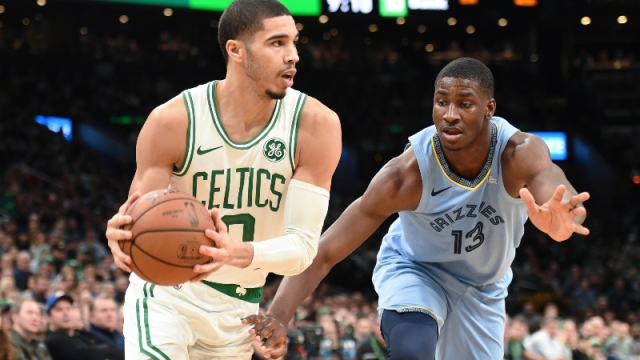 Boston Celtics forward Jayson Tatum (0) and Memphis Grizzlies forward Jaren Jackson Jr. (13)