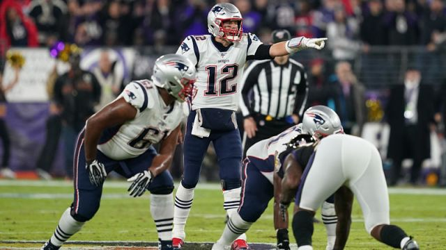 New England Patriots right tackle Marcus Cannon and quarterback Tom Brady
