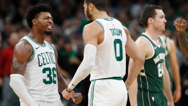 Boston Celtics guard Marcus Smart (36) and forward Jayson Tatum (0)