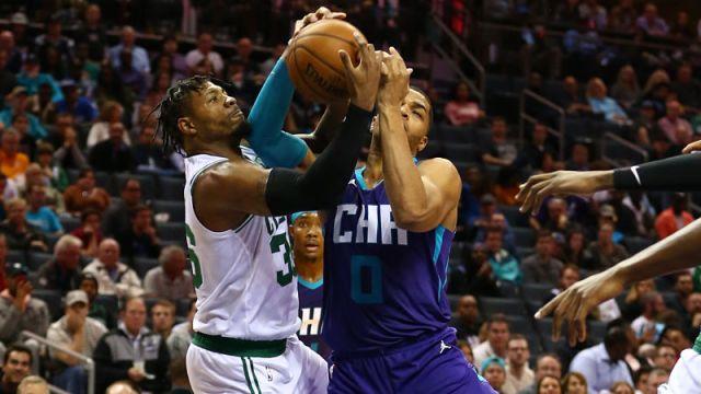Boston Celtics guard Marcus Smart and Charlotte Hornets forward Miles Bridges