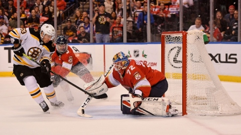 Boston Bruins left wing Brad Marchand (63) and Florida Panthers goaltender Sergei Bobrovsky (72)