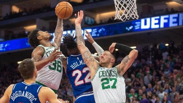 Boston Celtics guard Marcus Smart (36) and center Daniel Theis (27) and Sacramento Kings forward Richaun Holmes (22)