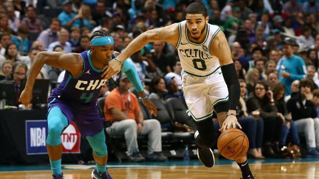 Charlotte Hornets guard Devonte' Graham and Boston Celtics forward Jayson Tatum