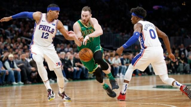 Boston Celtics forward Gordon Hayward (20) and Philadelphia 76ers forward Tobias Harris (12) and guard Josh Richardson (0)