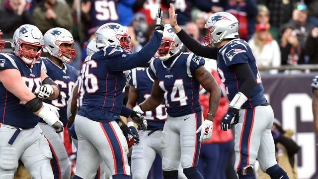 New England Patriots left tackle Isaiah Wynn and quarterback Tom Brady