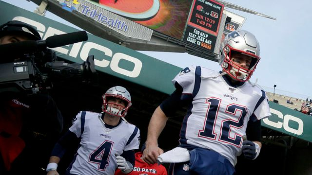 New England Patriots quarterbacks Jarrett Stidham and Tom Brady