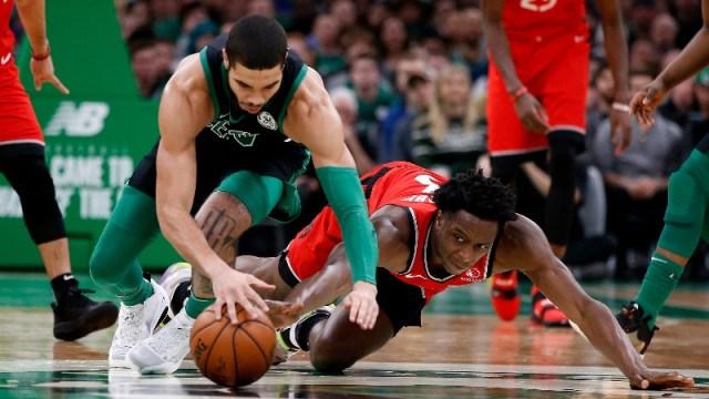 Boston Celtics forward Jayson Tatum (0) and Toronto Raptors forward OG Anunoby (3)