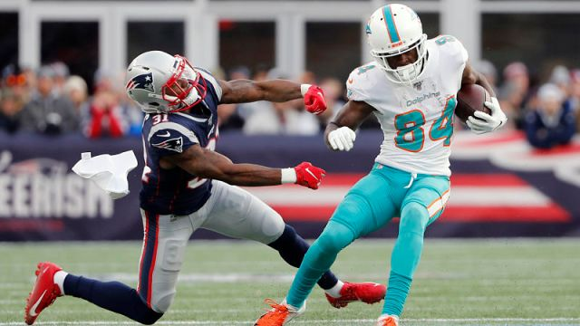 New England Patriots cornerback Jonathan Jones and Miami Dolphins wide receiver Isaiah Ford