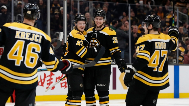 Boston Bruins' David Krejci, Danton Heinen, Brandon Carlo And Torey Krug