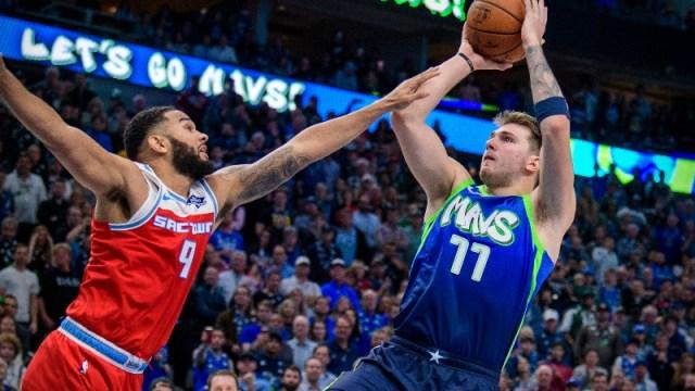 Dallas Mavericks forward Luka Doncic (77) and Sacramento Kings guard Cory Joseph (9)