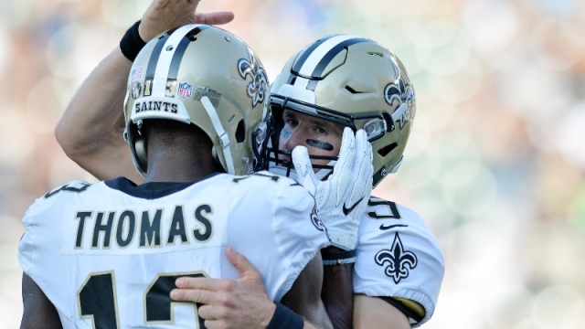 New Orleans Saints quarterback Drew Brees (9) and wide receiver Michael Thomas (13)