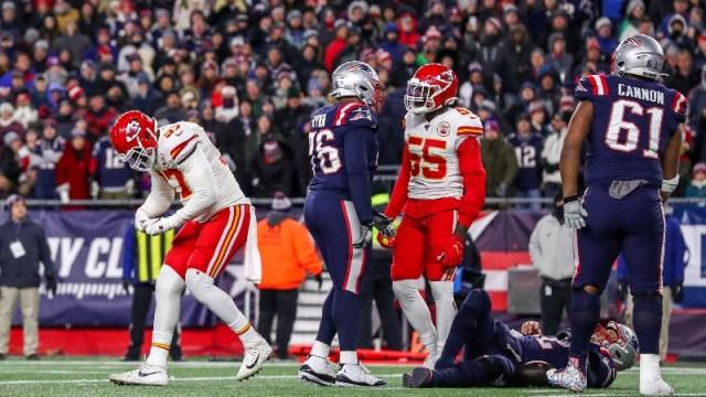 Kansas City Chiefs defensive end Alex Okafor (97) and New England Patriots quarterback Tom Brady (12)