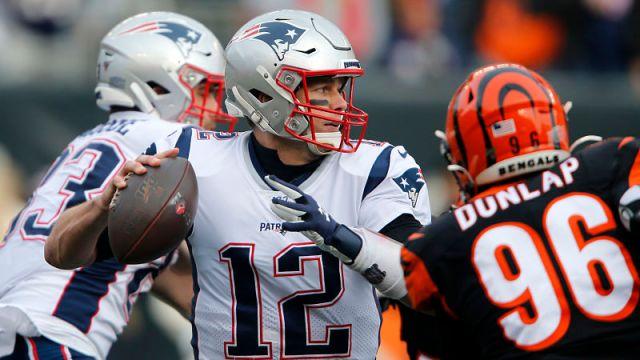 New England Patriots quarterback Tom Brady and Cincinnati Bengals defensive lineman Carlos Dunlap