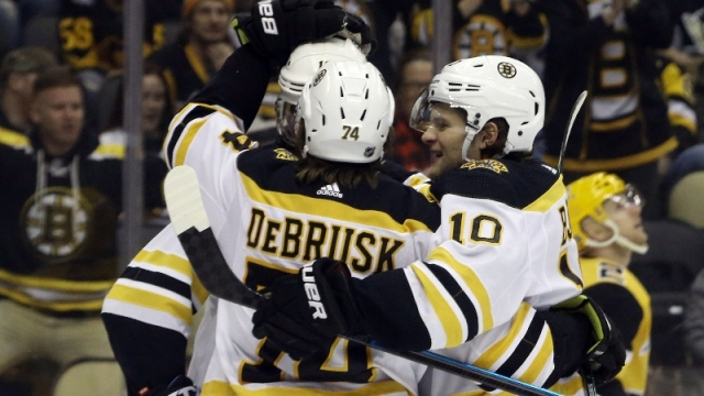 Boston Bruins left wing Anders Bjork (10) and Bruins left wing Jake DeBrusk (74)