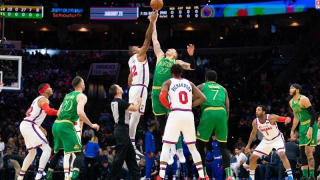 Philadelphia 76ers center Al Horford (42) and Boston Celtics forward Daniel Theis (27)