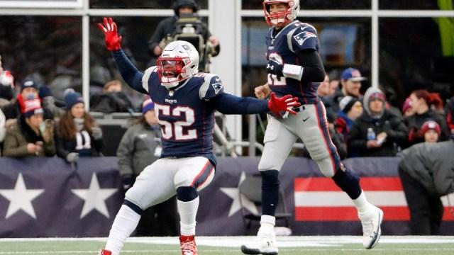 New England Patriots outside linebacker Elandon Roberts (52) and quarterback Tom Brady (12)