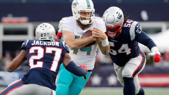 New England Patriots cornerback J.C. Jackson (27) and outside linebacker Dont'a Hightower (54), Miami Dolphins quarterback Ryan Fitzpatrick (14)
