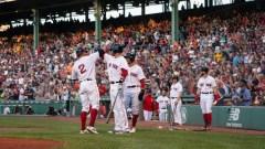 Boston Red Sox designated hitter J.D. Martinez (28) and shortstop Xander Bogaerts (2)