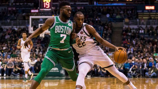 Boston Celtics guard Jaylen Brown and Milwaukee Bucks forward Khris Middleton