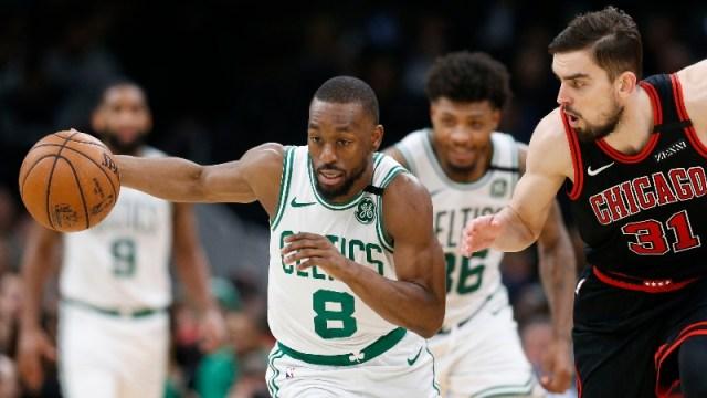 Boston Celtics point guard Kemba Walker (8) and Chicago Bulls guard Tomas Satoransky (31)