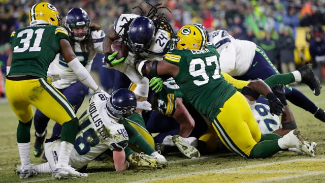 Seattle Seahawks running back Marshawn Lynch and Green Bay Packers defensive lineman Kenny Clark
