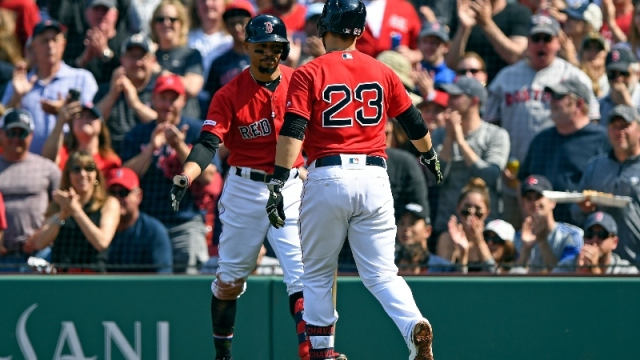 Boston Red Sox third baseman Michael Chavis (23) and right fielder Mookie Betts (50)