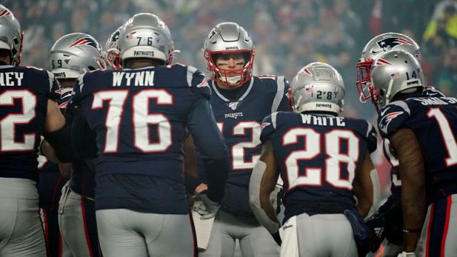 New England Patriots left tackle Isaiah Wynn, quarterback Tom Brady and running back James White