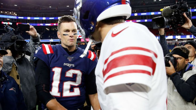 New England Patriots quarterback Tom Brady and New York Giants quarterback Daniel Jones