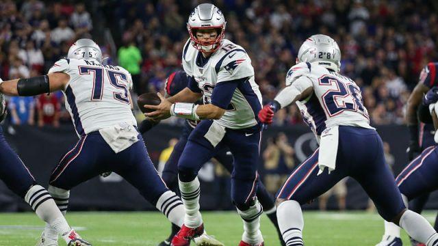 New England Patriots quarterback Tom Brady and running back James White