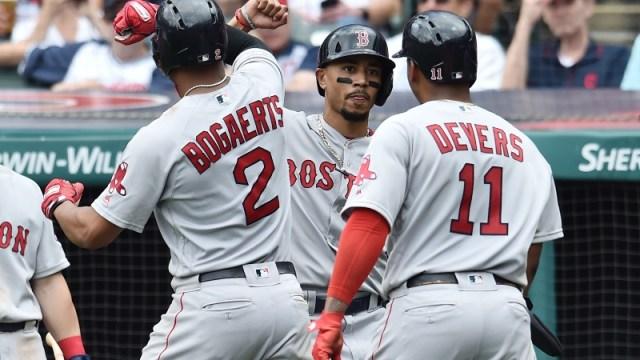 Boston Red Sox shortstop Xander Bogaerts (2), right fielder Mookie Betts (middle) and third baseman Rafael Devers (11)