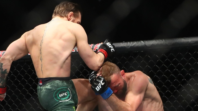 Conor McGregor with a knee to the head