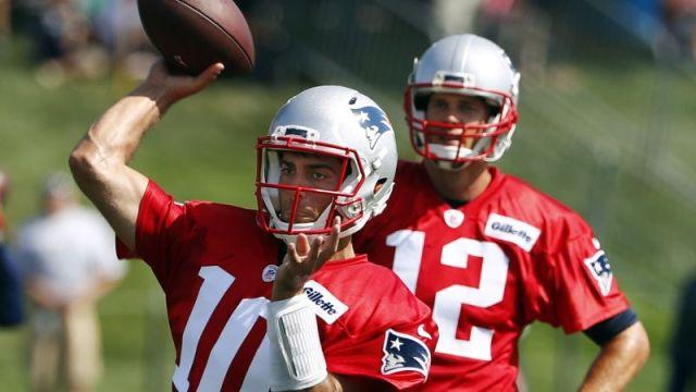 New England Patriots quarterback Tom Brady and Jimmy Garoppolo