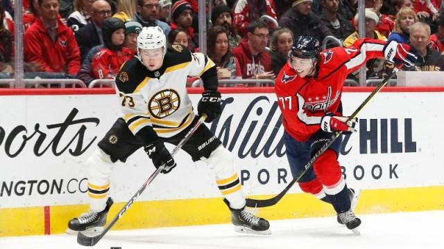Boston Bruins defenseman Charlie McAvoy (73) and Washington Capitals right wing T.J. Oshie (77)