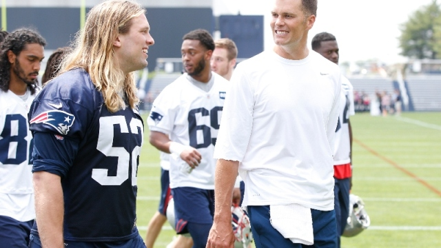 New England Patriots defensive end Chase Winovich (52) and quarterback Tom Brady (right)