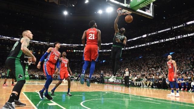 Boston Celtics guard Jaylen Brown (7) and Philadelphia 76ers center Joel Embiid(21)